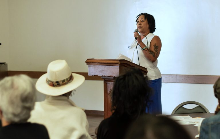 Cat Brooks speaks to the crowd at Taylor Memorial United Methodist Church in West Oakland. (Photo by: Saskia Hatvany)